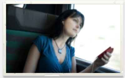 Woman watching recorded webinar on bus